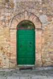 Green door. In an old brick wall Royalty Free Stock Images