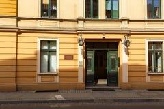 Old building facade in the center of Torun. Green door, old building facade, center of Torun, Poland Stock Photos