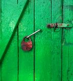 Green door and old lock. Old green wooden door and old lock Royalty Free Stock Photos