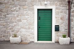 Green door in old stone house Stock Photography