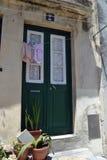 Green door. Old green door wiht big underwear hanging Stock Photo