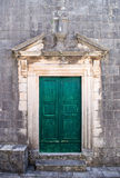 Green door in Perast old town Royalty Free Stock Photos