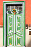 Green door on a red house Royalty Free Stock Image