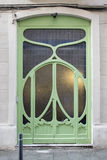 Green door with a Romantic flower like Modernist decoration in Gracia, Barcelona, Spain. Green door with a Romantic flower like Modernist decoration in Gracia Royalty Free Stock Photos