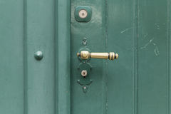 Green painted wooden door with straight golden knob Stock Photo