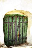 Green door to old wine cellar. Green wooden door to an old wine cellar Stock Image