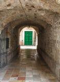Green Door Through Tunnel Stock Image