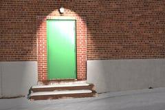 Green door under light Royalty Free Stock Images