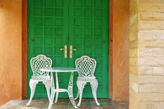 Green door and white classic chair Royalty Free Stock Photography