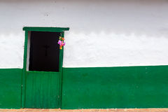 Green Door and White Wall Royalty Free Stock Photography