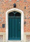 Green door with windows royalty free stock image