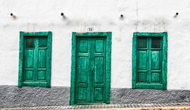 Green door and windows of an old house in Spain. Green door and window of an old house in Spain, Gran Canaria stock image