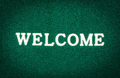 Green doormat and welcome text. For background Royalty Free Stock Image