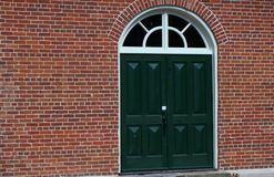 Green doors Stock Images