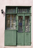 Green doors. Old Green doors and a winow in New Orleans Royalty Free Stock Images