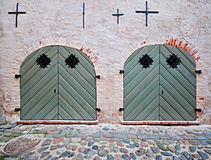 2 Green Doors. 2 green arched doors in a stuccoed brick wall on a cobblestone street Stock Images