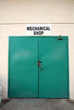 Green doors on shop Stock Images