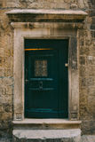 Green doors. Wood texture. Old shabby, irradiated paint. Stock Images