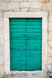 Green doors. Wood texture. Old shabby, irradiated paint. Old wooden doors Royalty Free Stock Photography
