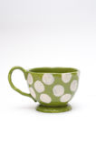 Green doted cup Stock Photo