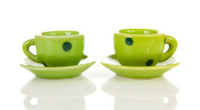 Green dotted tableware cups Royalty Free Stock Image
