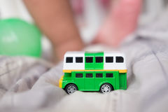 Green double decker bus toys Stock Image