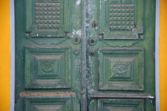 Green double doors. Slightly weathered green double doors in Atalaia Royalty Free Stock Photo