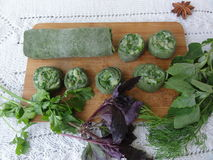 Green dough roll cooked from nettle and wild plants Stock Images