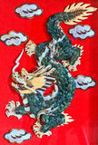 Green dragon. On the red background Stock Images