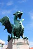 Green Dragon on bridge in a summer day in Ljubljana, Slovenia Stock Photography