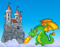 Green dragon with castle on hill royalty free stock photography