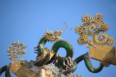 Green dragon on the china roof Stock Photo