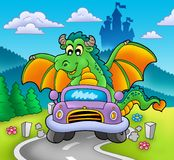 Green dragon driving car stock photo