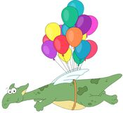 Green dragon flying on colored balloons. Stock Image