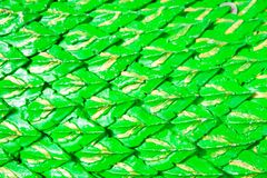 Green dragon scales background or Serpent stucco Stock Photo
