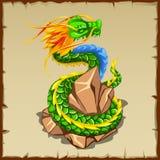 Green dragon wraps around the stone Royalty Free Stock Photo