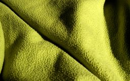 Green drapery. Green coloured textile, wool surface Stock Image