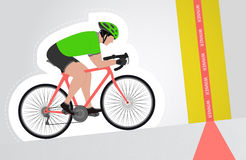 Green dressed cyclist riding upwards to finish line   Stock Photography