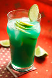 Green drink. Green alcohol drink with lemon Royalty Free Stock Photo