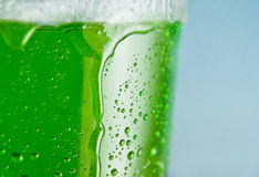 Green drink. Cool green drink on blue background Stock Image