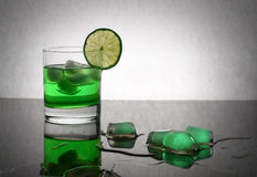 Green drink and ice. Cubes of ice in fresh green drink stock images