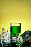 Green drink with ice cubes Stock Photo