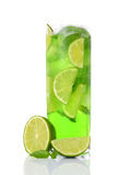 Green drink with lime and mint. On white background royalty free stock photography