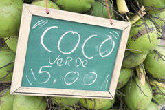 Green Drinking Coconuts for Sale Sign in Brazil Stock Photography