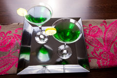 Green Drinks. Brightly lighted and colorful Martini cocktails with lemon stock images