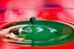 Green droplet of liquid paint falling Stock Photo