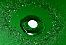 Green drops. Drops on a background of a checkered structure. Green toning Royalty Free Stock Images