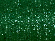 Green drops. Drops and droplets of green water Stock Image