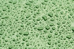Drops of Rain or Water Drop on the Hood of the Car. Rain Drops o. Green Drops of Rain or Water Drop on the Hood of the Car. Rain Drops on the Surface of the Car royalty free stock images