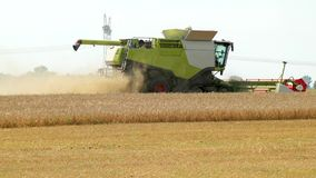 A Green Dry Harvester With A White Part Of The Crop Harvests The Harvest During Harvest. Part Of The Field Is Already stock video footage